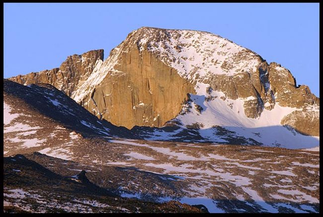 A snow topped Longs Peak of Rocky Mountain National Park in Colorado is the perfect mountain to represent Prayer Rock.