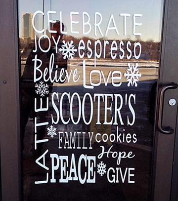 A Scooters Coffee entrance with the words celebrate, joy, believe and peace