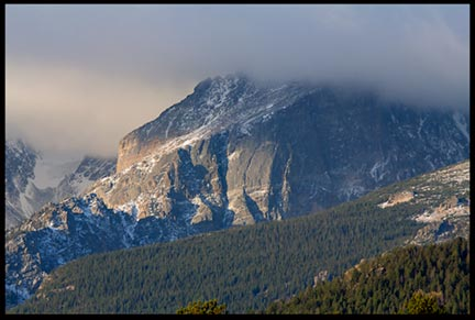 The morning lights hits mountain covered with fog in Rocky Mountain National Park