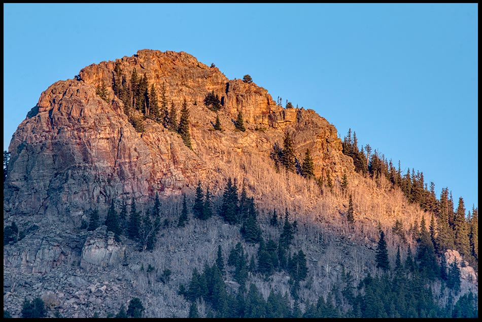 The alpine glow streaks the peak of Estes Cone in Rocky Mountain National Park, Colorado and 1 Chronicles 29:11 Nature photo and Bible Verse of the Day
