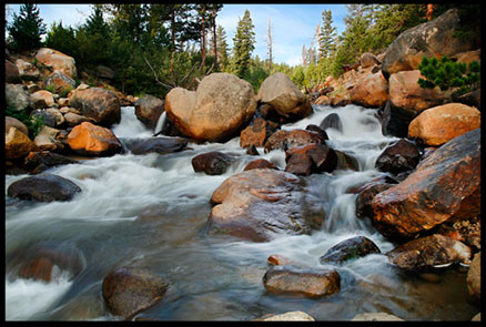 A small cascade of water through rocks on the Fall River in Rocky Mountain National Park.