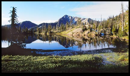 A mountain reflects in a lake Bob Marshall Wilderness