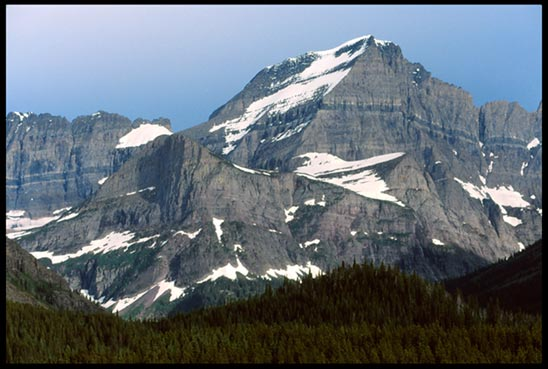 A grey mountain benneth a grey sky in Waterton Lakes National Park, Canada to represent the mountain of God's Word