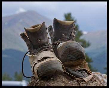 A well worn pair of hiking boots. When we walk up the mountain of God's Word we will wear out our Bibles