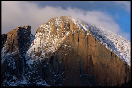 Clouds cling to the summit of Longs Peak at day break