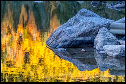 The colors of fall reflected in Bear Lake, Rocky Mountain National Park, Colorado