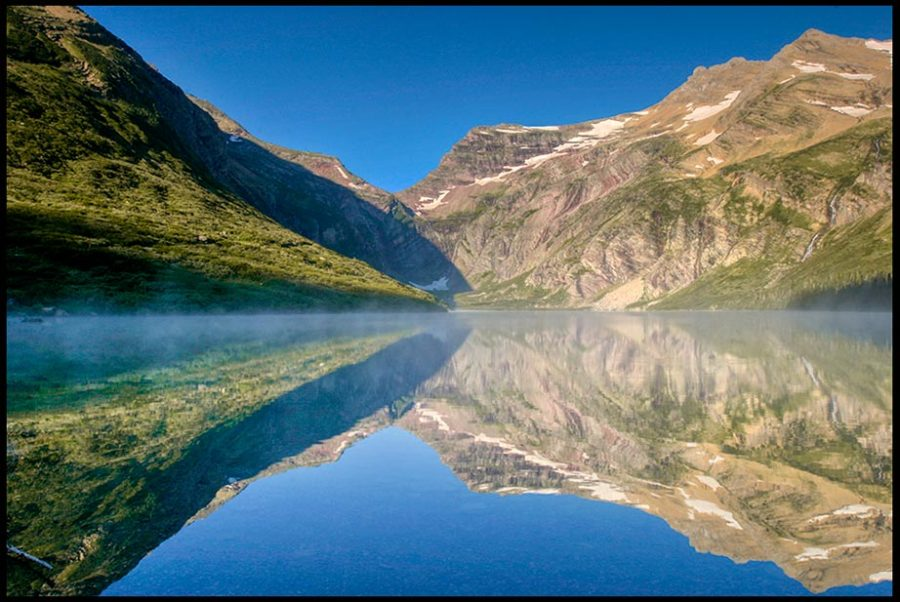 """Mountains and blue sky reflected in Gunsight Lake, Glacier National Park, Montana and Psalm 27:4. """"the ouse of the Lord"""