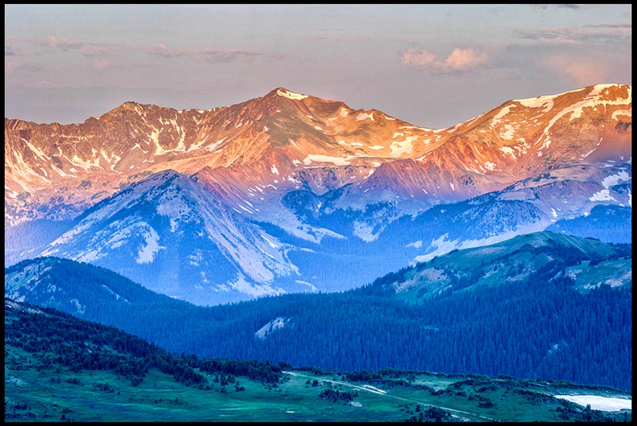 The Never Summer Mountain Range at sunrise in Rocky Mountain National Park, Colorado and Isaiah 52:7 bible verse our god reigns