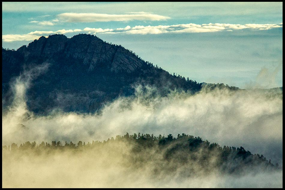 Low morning clouds linger on a mountain in Roosevelt National Forest, Colorado and I Kings 8:11b-13 Bible verse That God would dwell