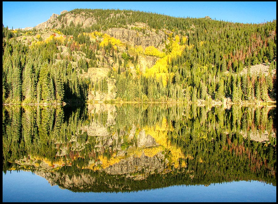 Bear Lake in Autumn with yellow aspens, Rocky Mountain National Park, Colorado and Psalm 89:11. The earth belongs to God