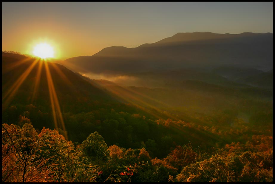 The Sun rises over the mountains and fog of Great Smoky Mountains National Park, Tennessee and Bible verse Job 38:12 God commands the morning