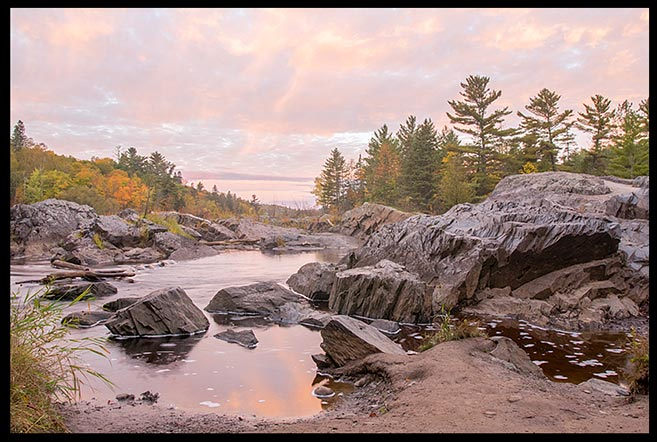 Rocks along the Saint Louis River just before sunrise in Jay Cooke State Park, Minnesota and Matthew 7:24-25, the rock of Christ teaching