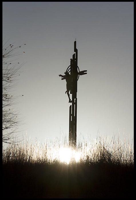 A silhouetted Christ on the cross for Good Friday, the Holy Family Shrine, Eastern Nebraska. Christ's Sabbath Rest