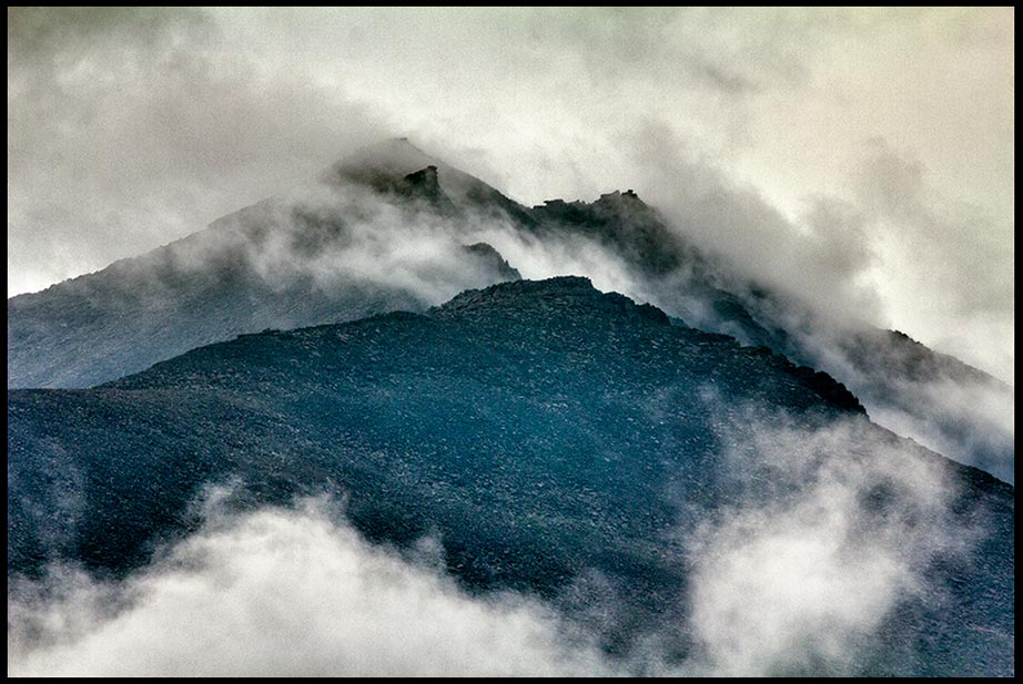 Rugged mountains covered with fog and a heavy mist Rocky Mountain National Park, Colorado and Bible verse Psalm 102:2-3 a shrouded view of God