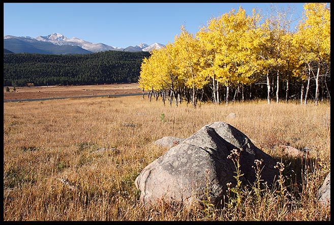 A large boulder and yellow fall aspen trees in Moraine Park with Longs Peak in the background, Rocky Mountain National Park, Colorado and Ephesians 2:19-20. Christ Jesus Himself being the cornerstone