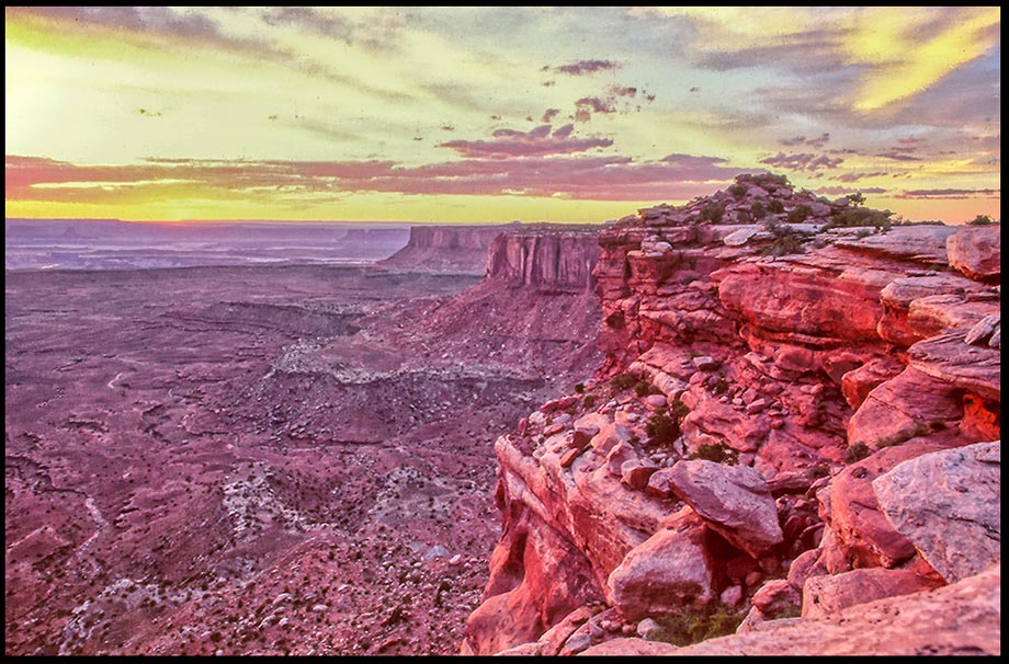 The radiant light of a post sunset sky seen from the red rocks of Island in the Sky, Canyon Lands National Park, Utah Bible verse of the day His glory: