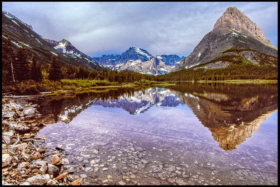 A calm and still mountain lake in the Canadian Rockies, Waterton Lakes National Park, Alberta, Canada. Calm in the storm