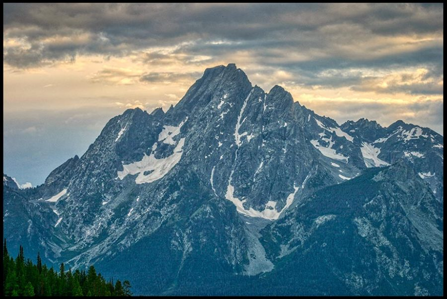 The sunsets behind Mount Moran, Grand Teton National Park, Wyoming and Isaiah 66:1 Bible verse the earth is my footstool