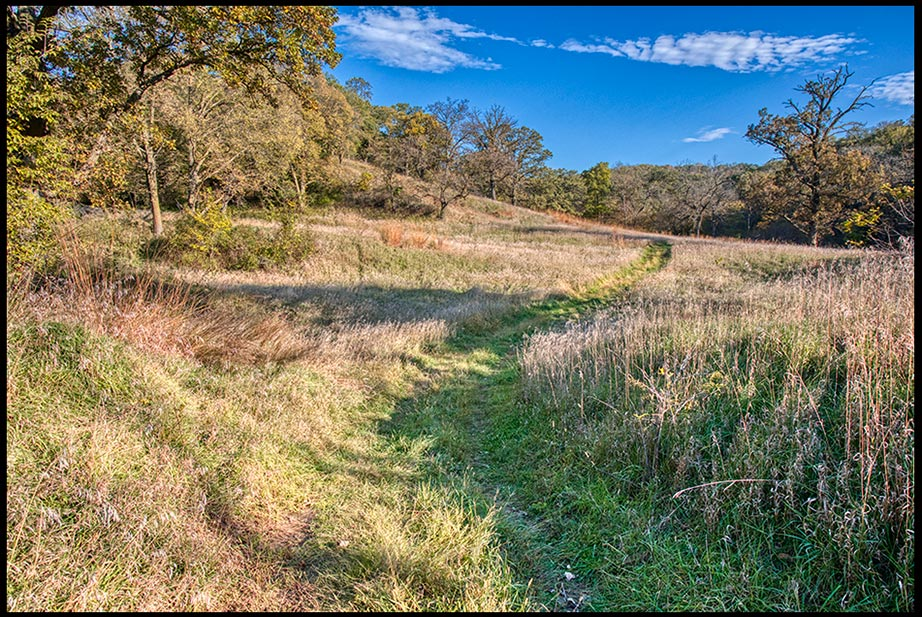 A path through a meadow in early fall under a blue sky, Hitchcock Nature Center, Iowa. Wisdoms Pleasant Ways
