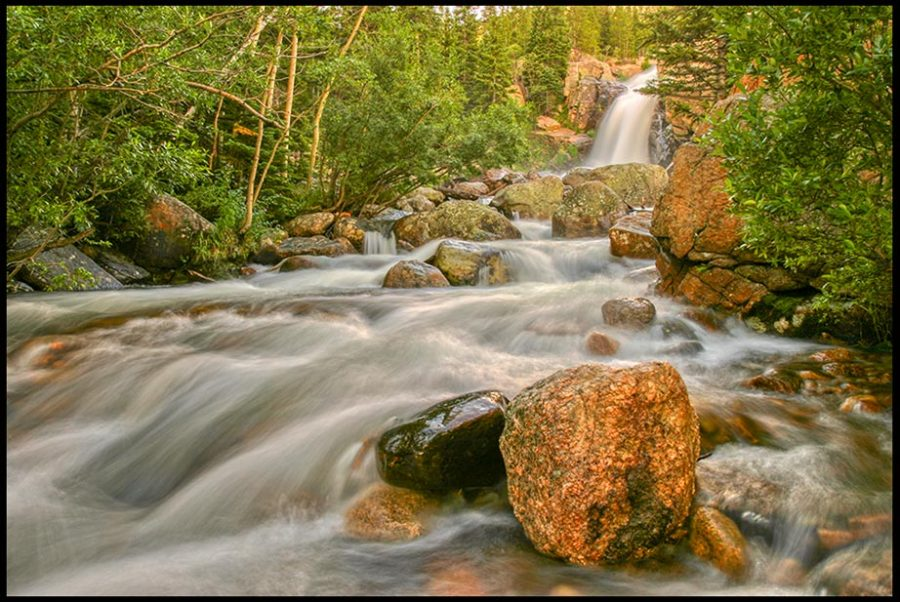The peaceful flow of a mountain stream below Alberta Falls, Rocky Mountain National Park, Colorado and John 4, Jesus and eternal life in living water