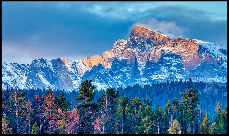 """Snow covered mountains and Stormy Skies, Rocky Mountain National Park, Colorado and Psalm 148 Bible verse """"Let them praise the name of the LORD."""""""