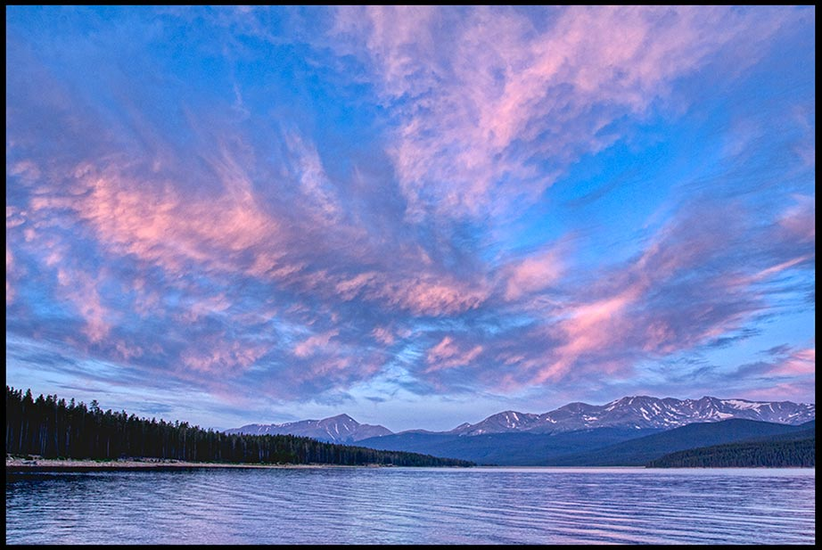 Clouds glow red in a pre-dawn Sky over Turquoise Lake, San Isabel National Forest, Colorado and Psalm 8:1 Bible Verse of the Day about how majestic