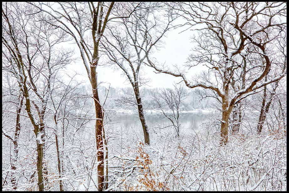 The historic Missouri River seen through snow covered trees, Fontenelle Forest, Bellevue, Nebraska.  A tranquil heart Proverbs 14:30a