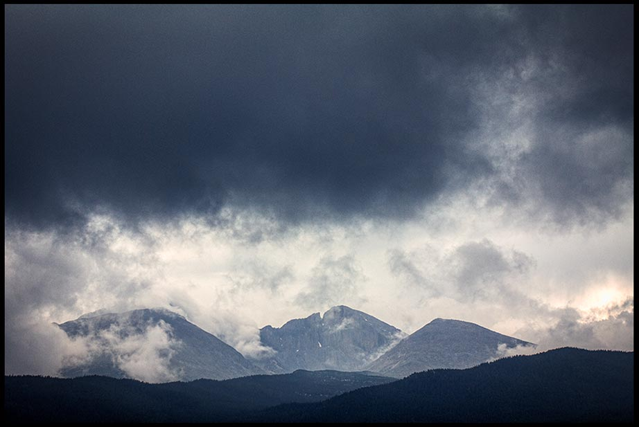 Storm clouds over Longs Peak and other mountains in Rocky Mountain National Park, Colorado and Nahum 1:3 Bible verse and God's wrath