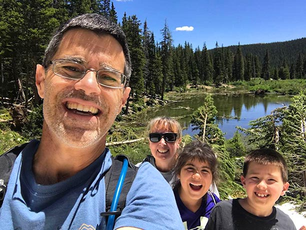 A family selfie of Pat Mingarelli and his wife and their two kids. Pat runs the Visual Bible Verse of the Day website