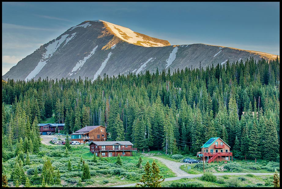 Homes on hillside over dwarfed by a mountain submit , Summit County, Colorado. John 14:2,heavenly dwelling places