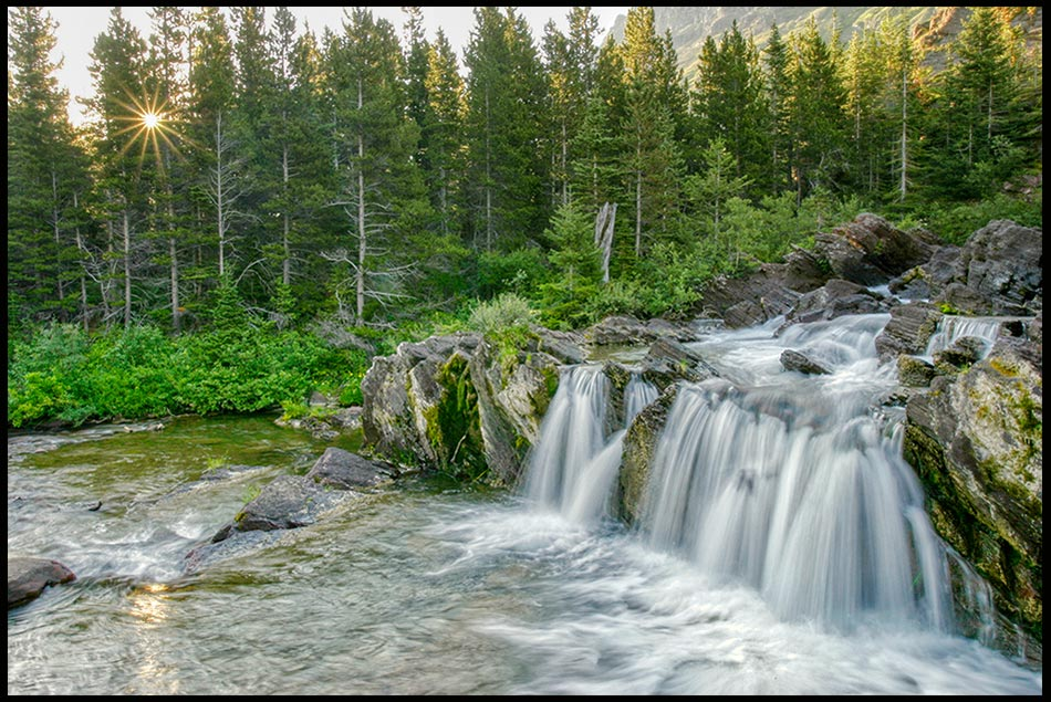 Redrock Falls splashes into a pool of water at sunrise, Glacier National Park, Montana and Psalm 51:1-2 bible verse on Wash me from my sin