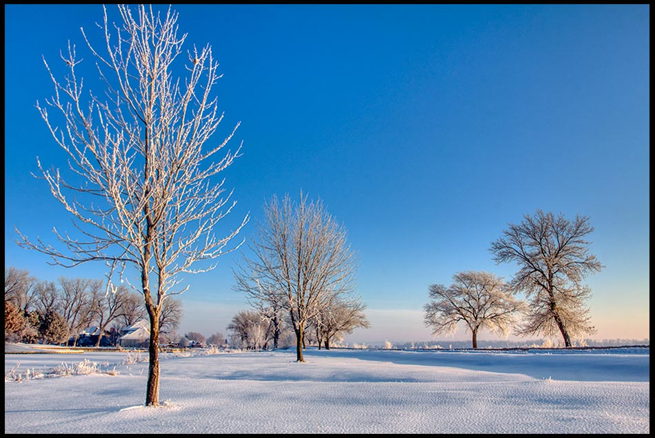 A park covered with light snow and hoarfrost under blue sky, Lake Manawa State Park, Iowa.Bible Verse of the Day: Psalm 50:1-2: God's Perfection of beauty