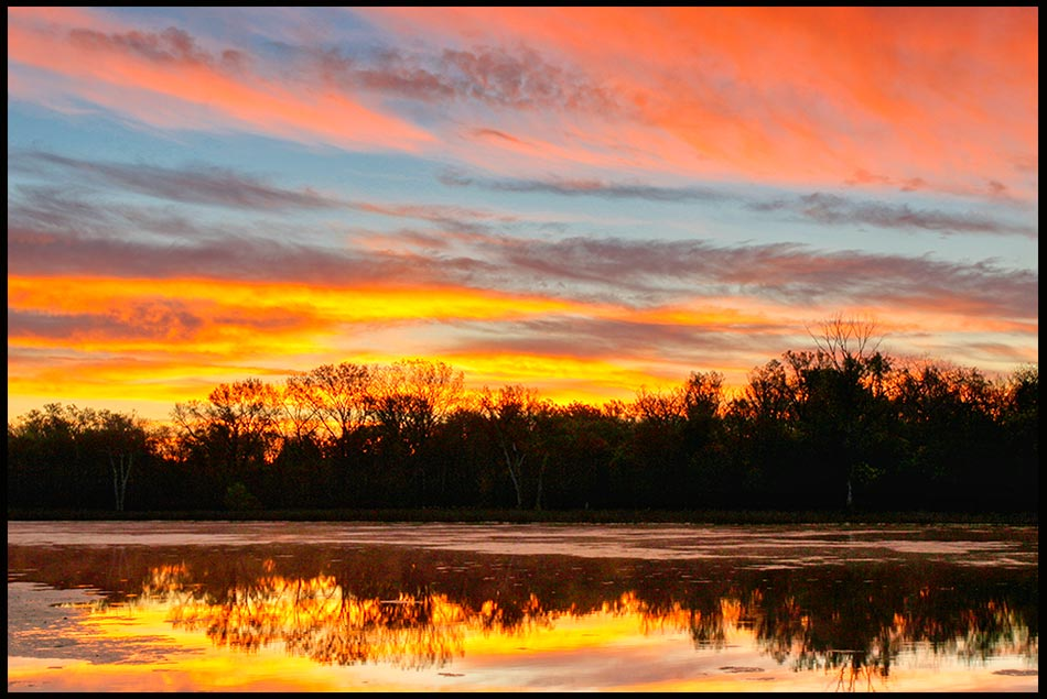 An orange, red and blue sunrise at Fontenelle Forest, Nebraska and Psalm 19 bible verse