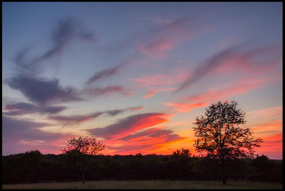 """A red and blue sunset sky with clouds, Mahoney State Park, Nebraska and Bible verse Psalm 104:2-3. """"The Lord wraps light"""