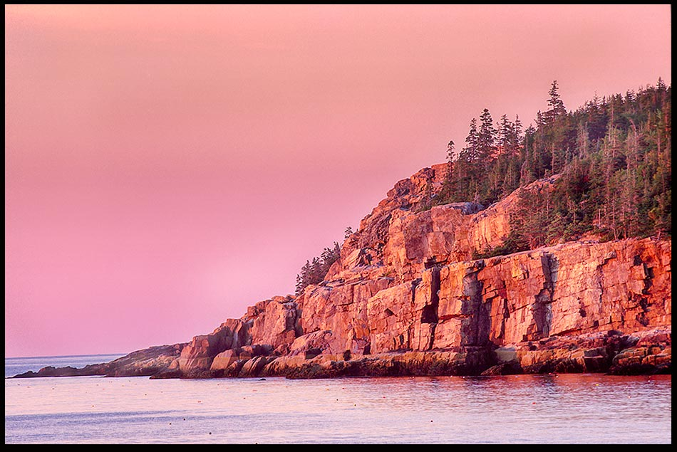 The red glow of sunrise hits the Otter Cliffs of Acadia National Park, Maine and Psalm 108:4-5 Be exalted, O God