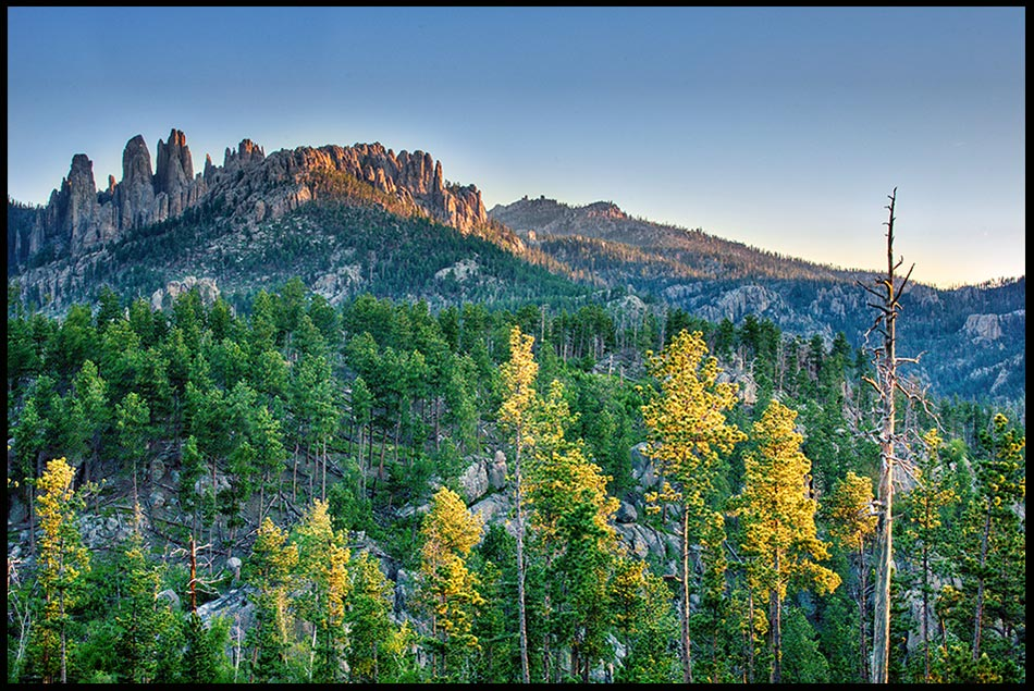 The Pinnacles rock formation above the surrounding landscape at sunrise, Black Hills, South Dakota. Bible Verse of the Day: Acts 17:24-25. The God who made the world