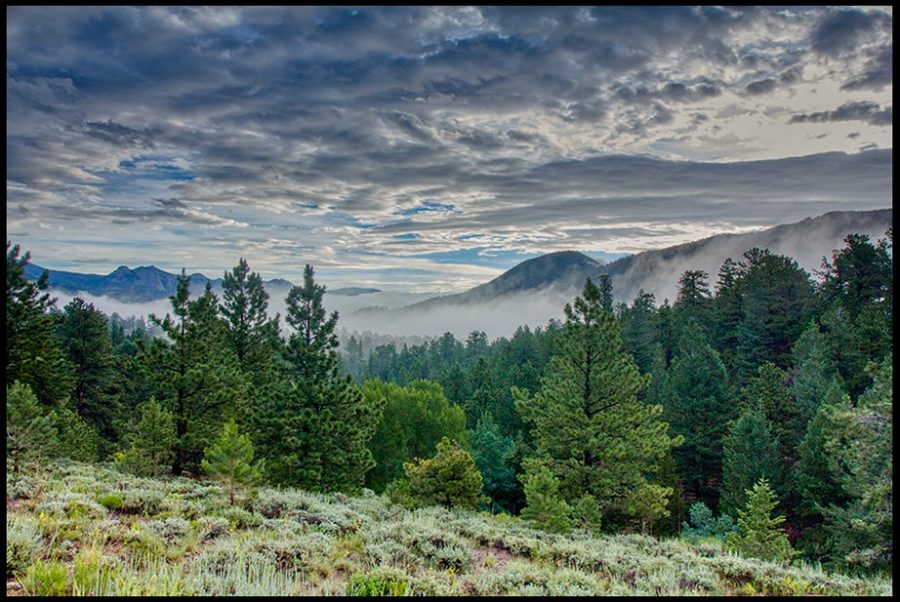 Morning fog and clouds begin to clear over the mountains and forest, Rocky Mountain National Park, Colorado and Acts 3:19-20 Bible Verse on refreshing