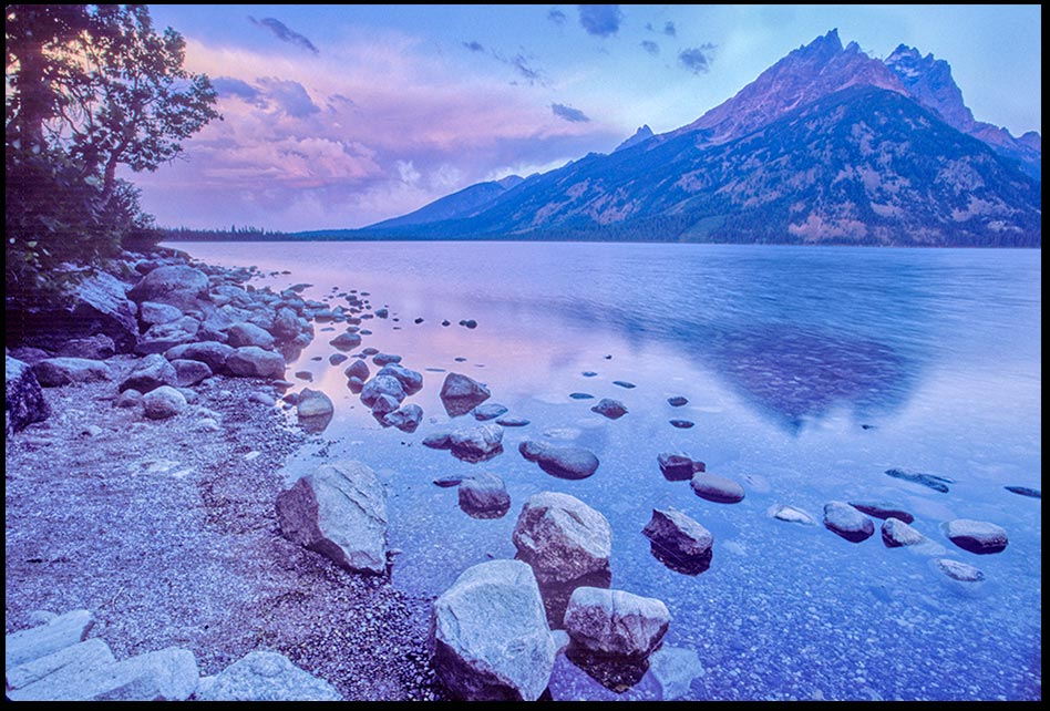 Purple storm clouds above Jenny Lake and Mount Teewinot at sunrise, Grand Teton National Park, Wyoming and Colossians 1:16 Bible verse God created heaven and earth